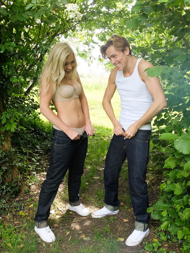 A man and woman putting Shreddies jeans on