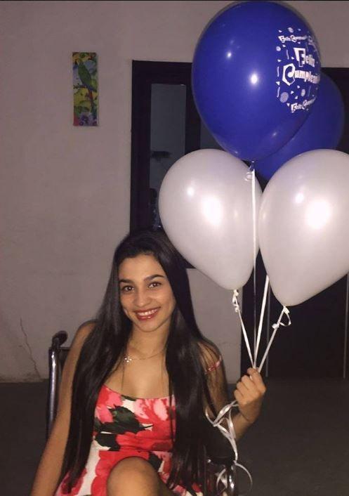 Luisa Fernanda Buitrago holding balloons