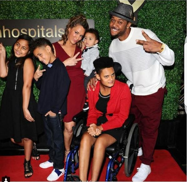 Pooch Hall posing with his family