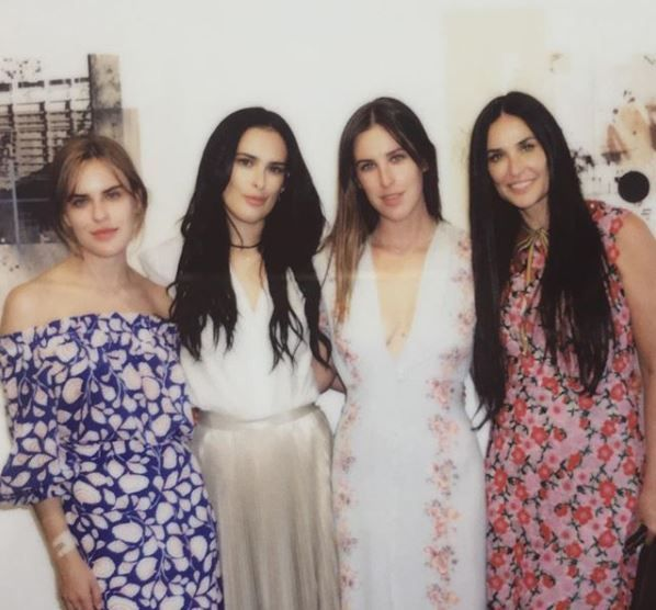 Rumer Willis poses with her mother, Demi Moore, and sisters Tallulah and Scout.