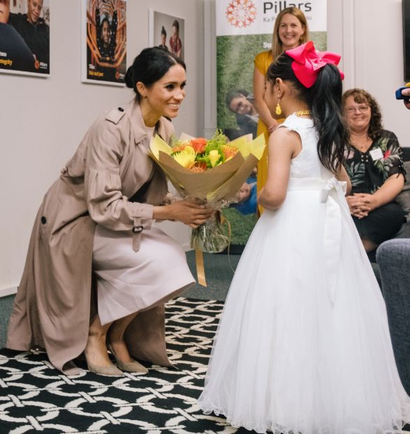 Meghan Markle receives flowers from a little girl in New Zealand
