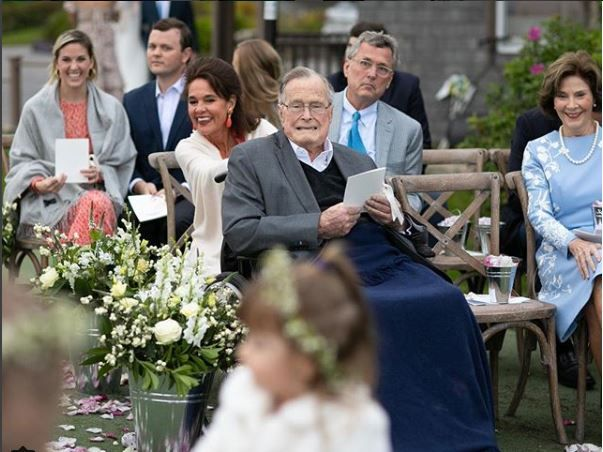 George H.W. Bush and Laura Bush watch the flower girls at Barbara Bush's wedding