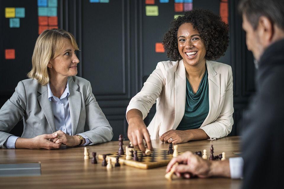 Woman winning at chess