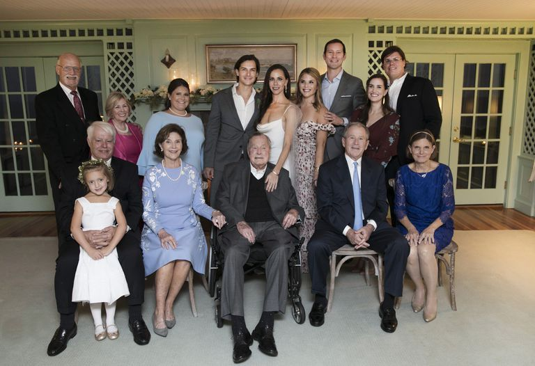 The newlyweds pictured with their families