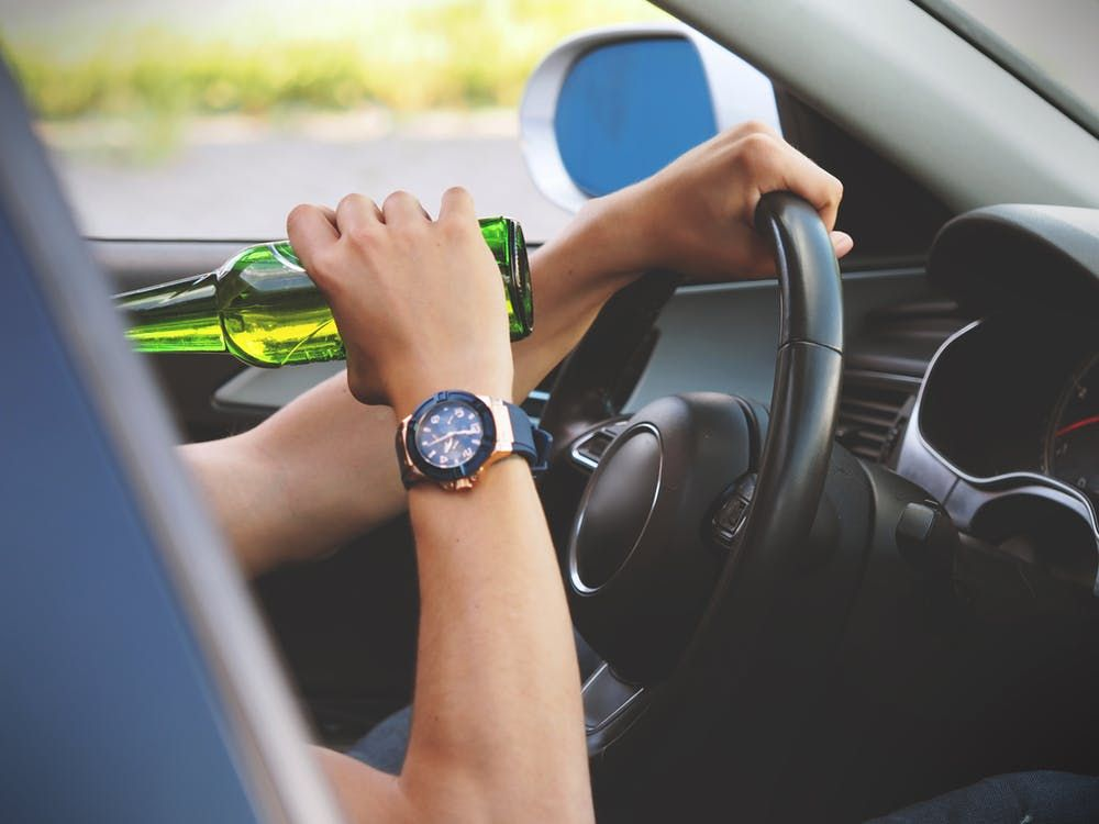 A man drinking and driving