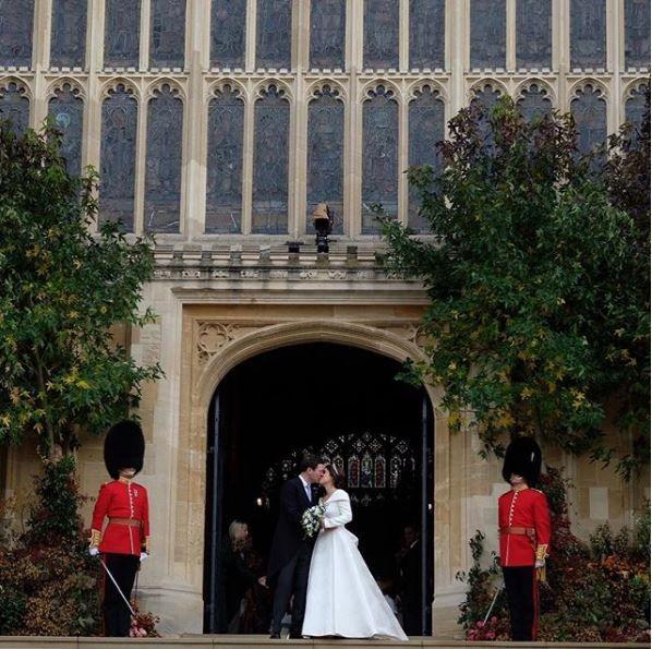 Princess Eugenie and Jack kiss at the chapel