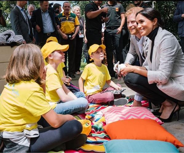 Prince Harry and Meghan speaking to well-wishers in Melbourne, Australia