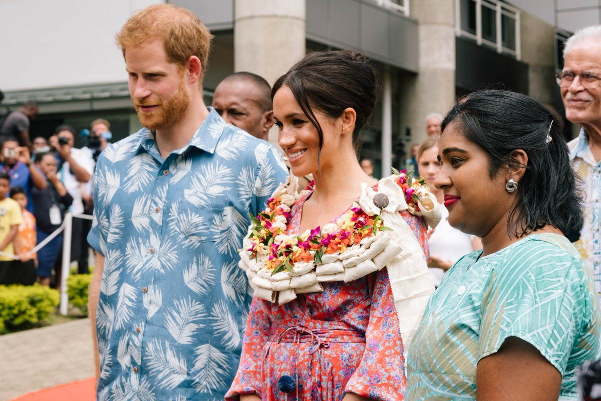 Meghan and Harry pose with Elisha Azeemah Bano, the founder of the Act It Network.