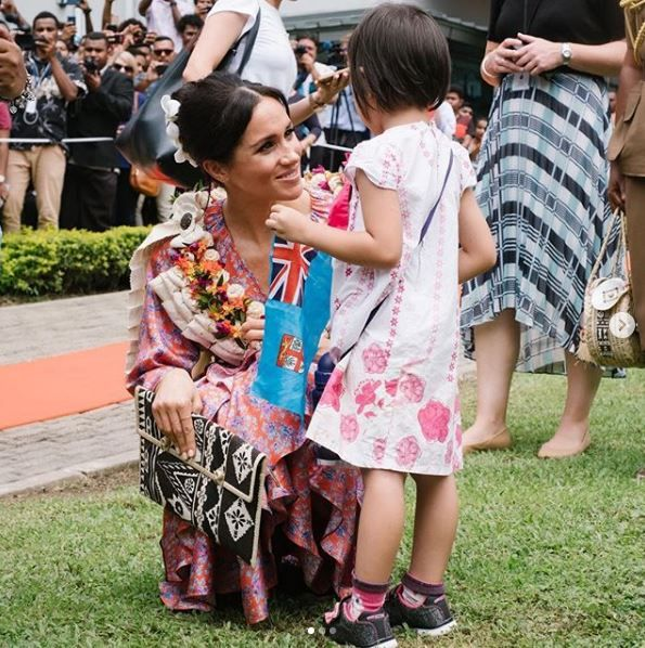 Meghan Markle talks to young girl in Suva, Fiji.