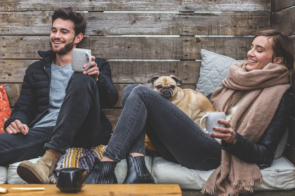 A couple with a dog