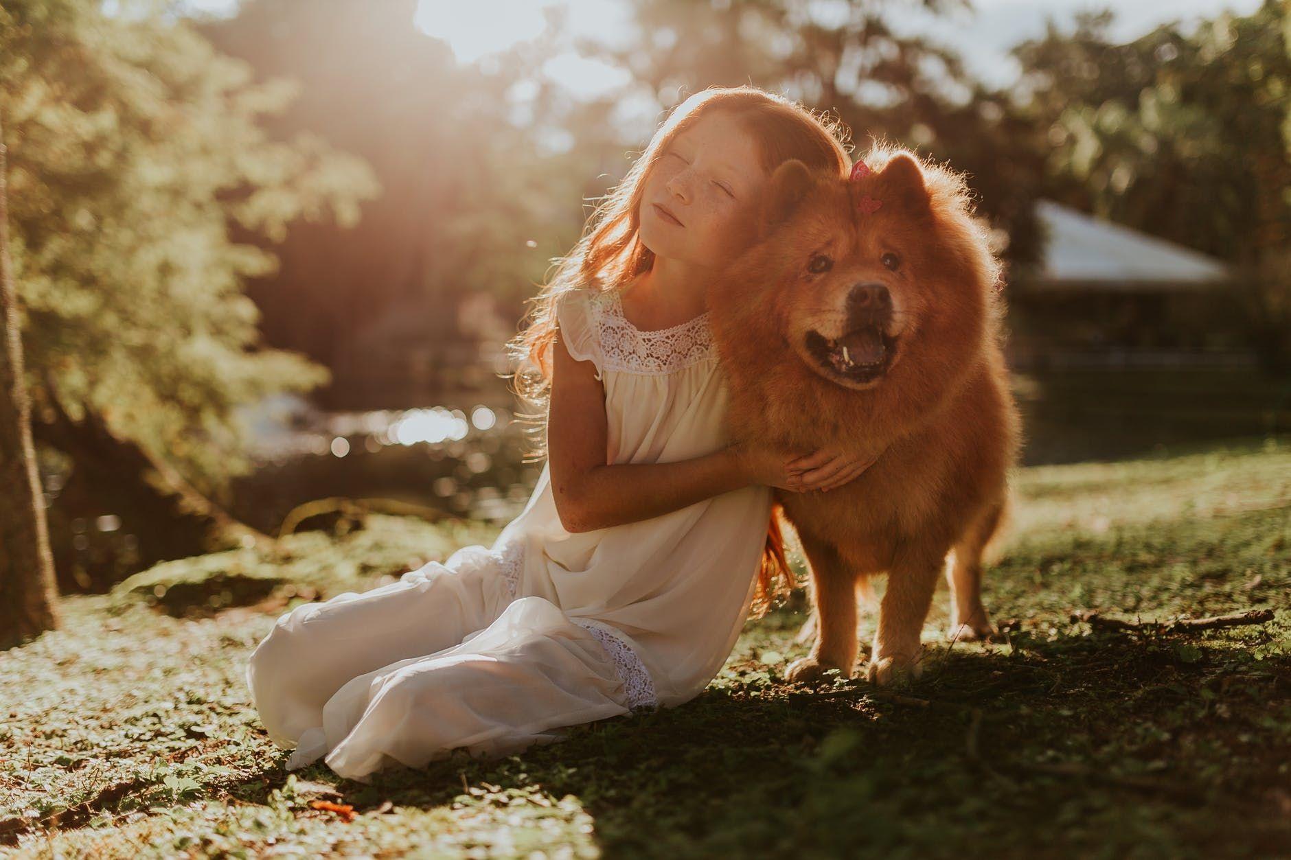 child hugging dog