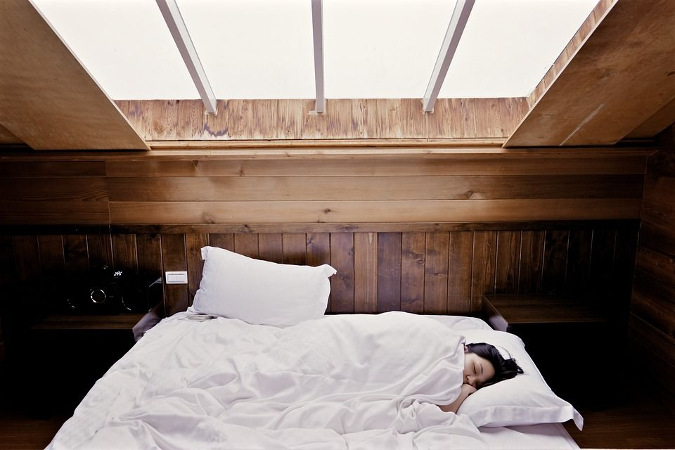 Woman laying in bed sleeping