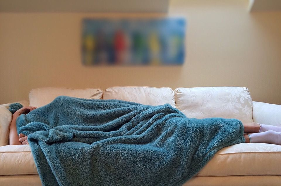 A person sleeping on the couch