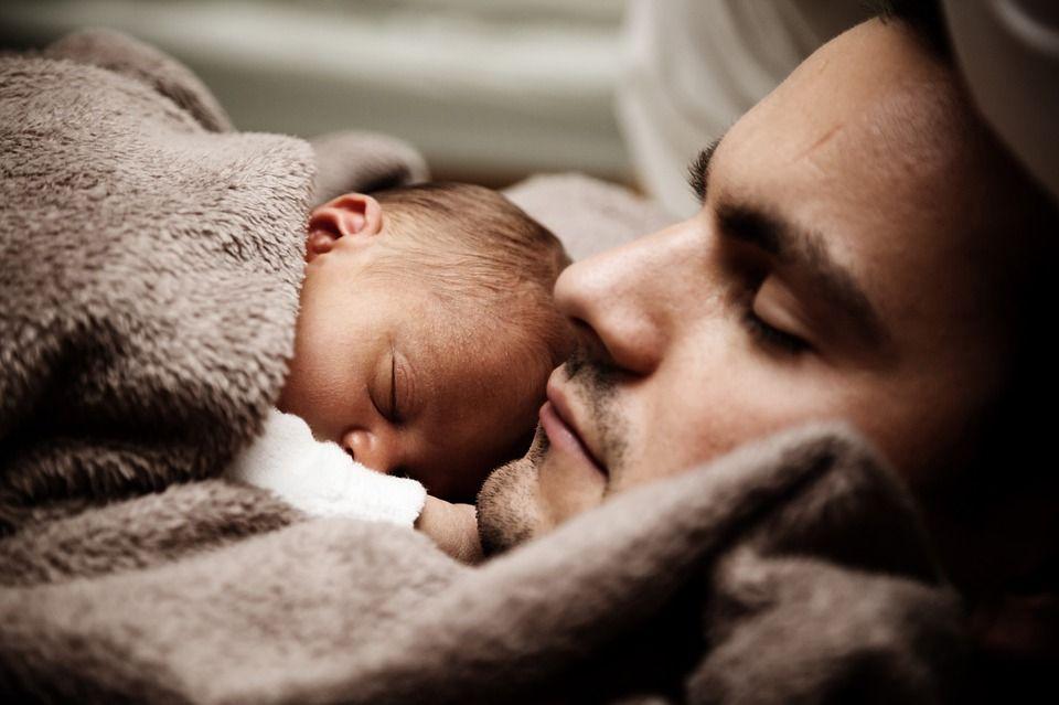 Man sleeping with baby