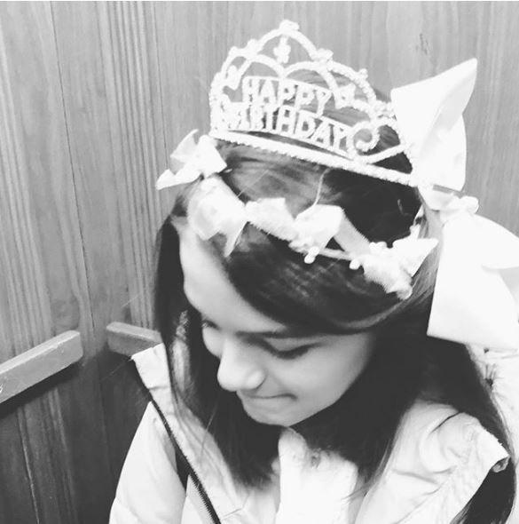 Suri Cruise wearing a birthday crown
