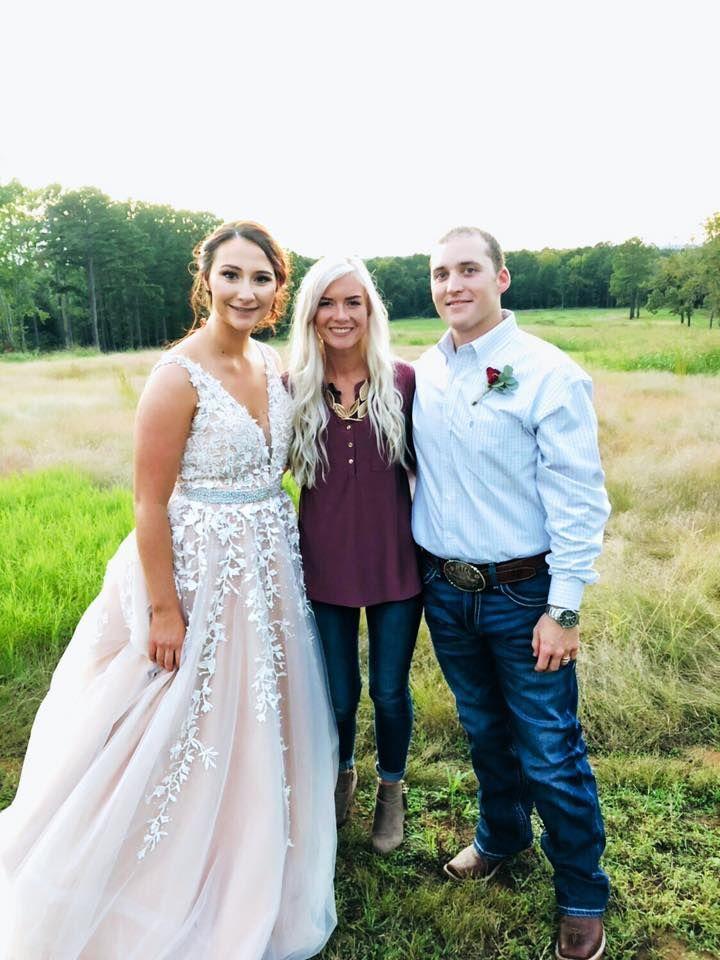 Kolbie Sanders with the bride and groom