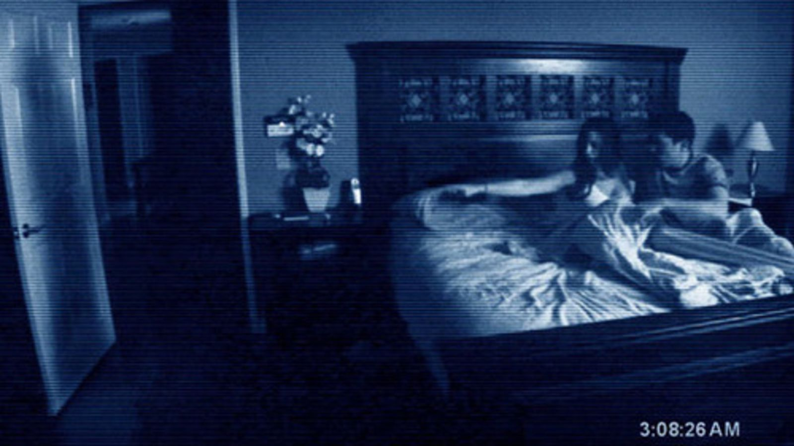 Katie Featherston and Micah Sloat see a shadow in their bedroom in 'Paranormal Activity'
