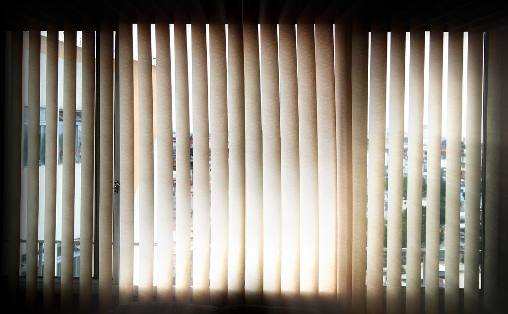 sun shining through blinds