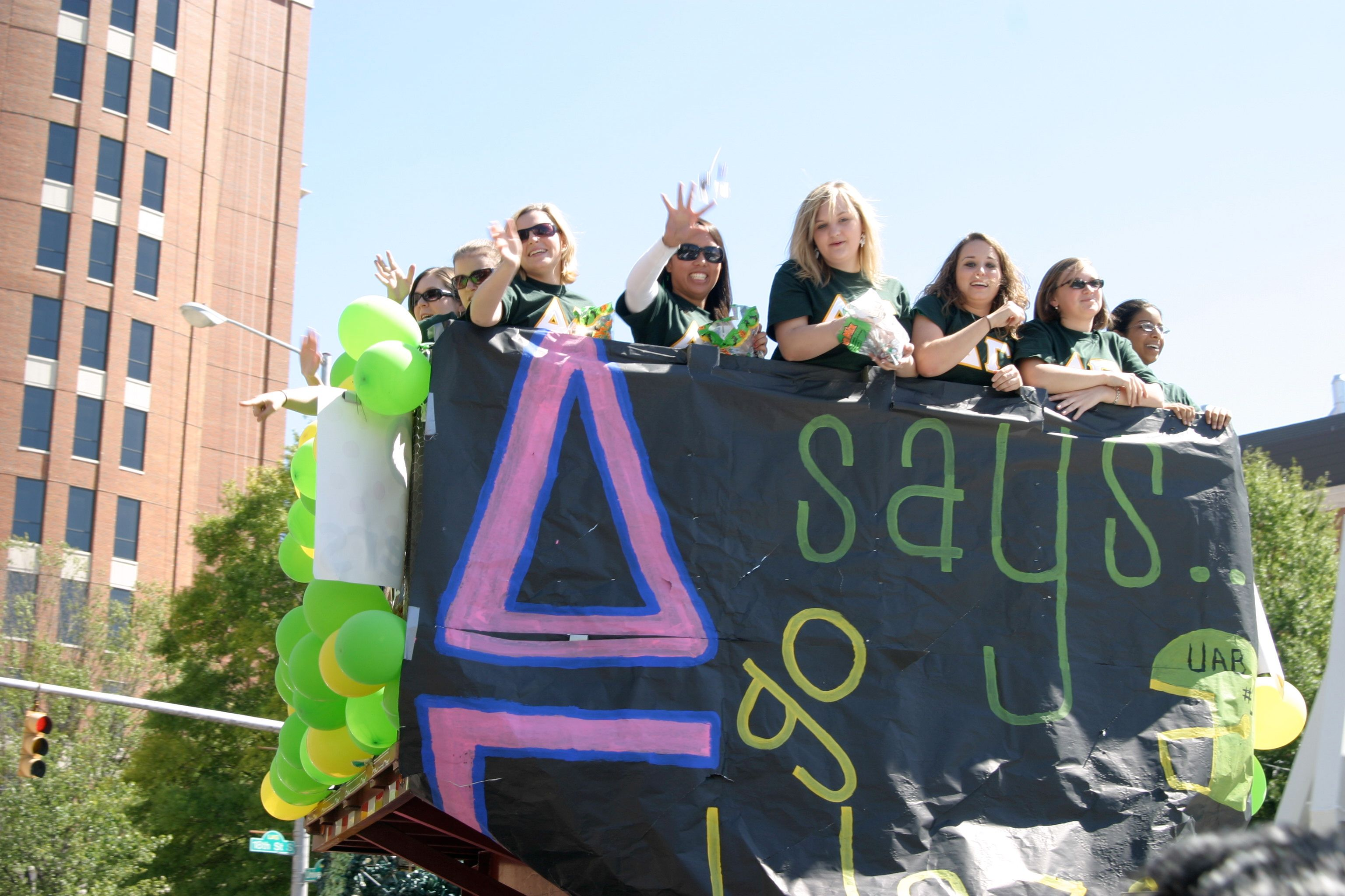 A group of sorority girls at their university's homecoming parade.