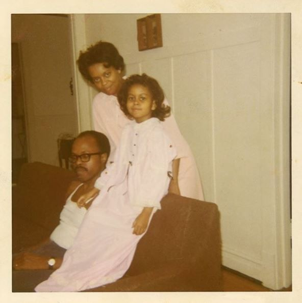 A young Michelle Obama with her parents