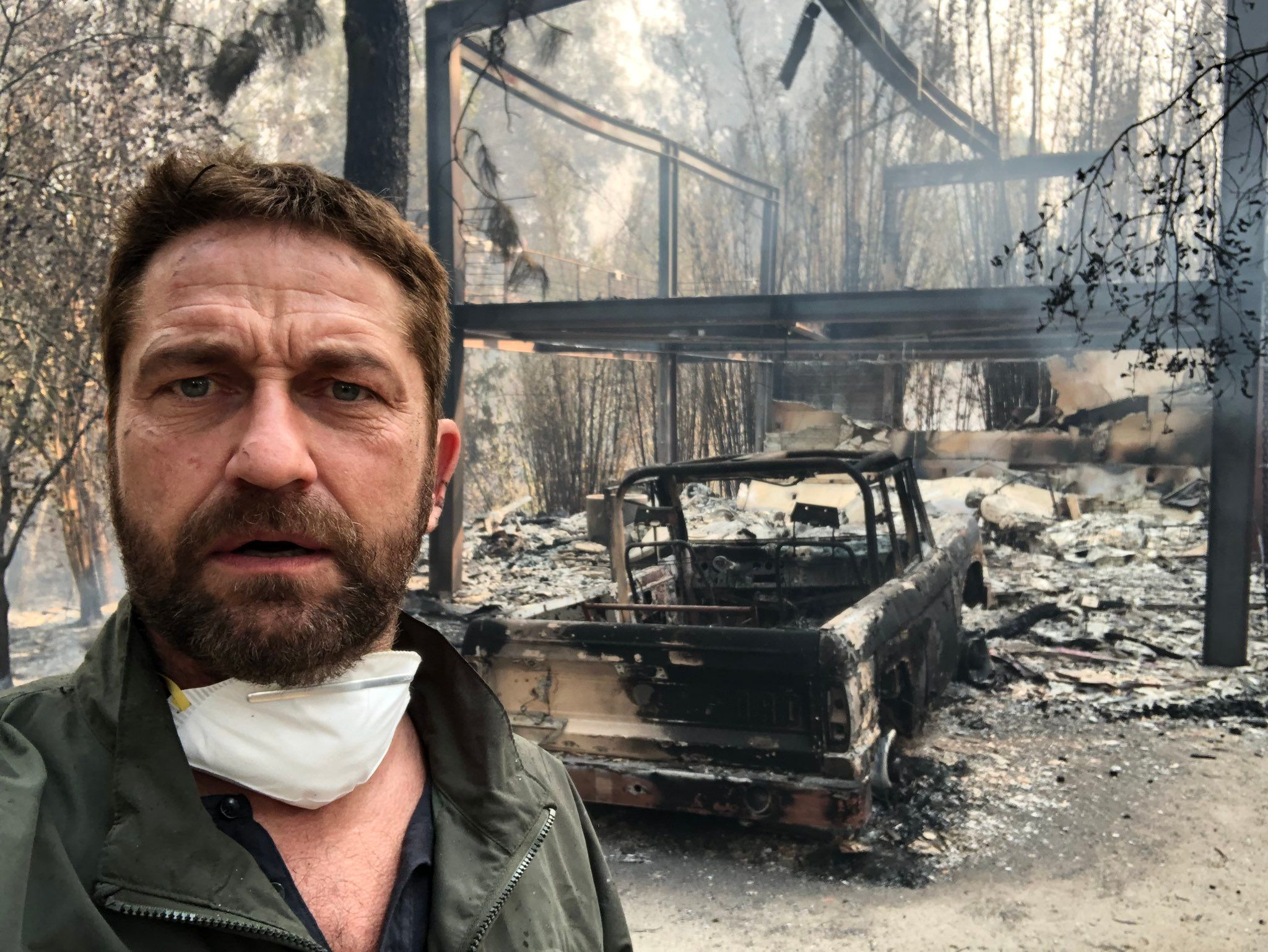 Gerard Butler takes a selfie in front of his burnt down Malibu home