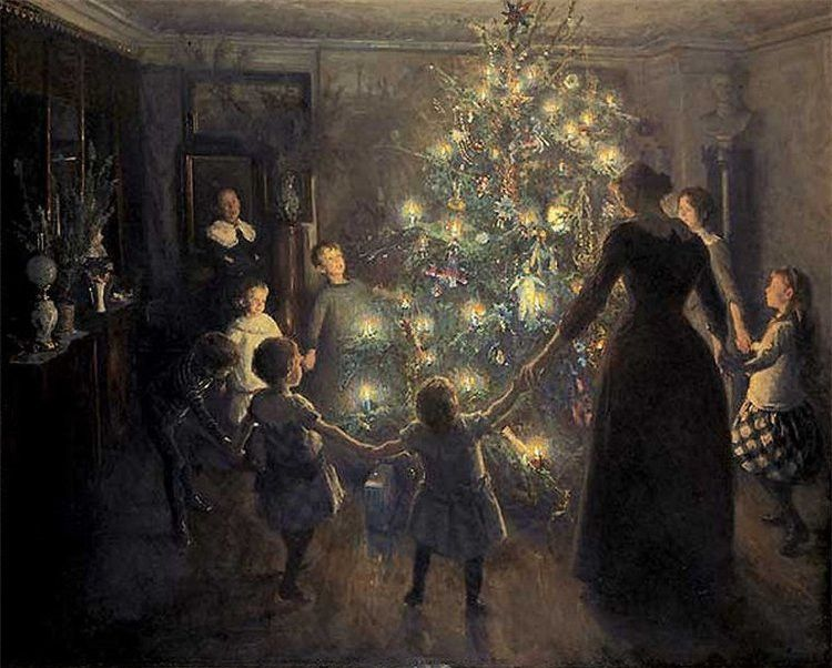 Woman with family around the Christmas tree