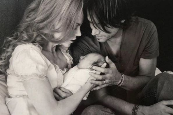 Nicole Kidman and Keith Urban cradling an infant Sunday Rose