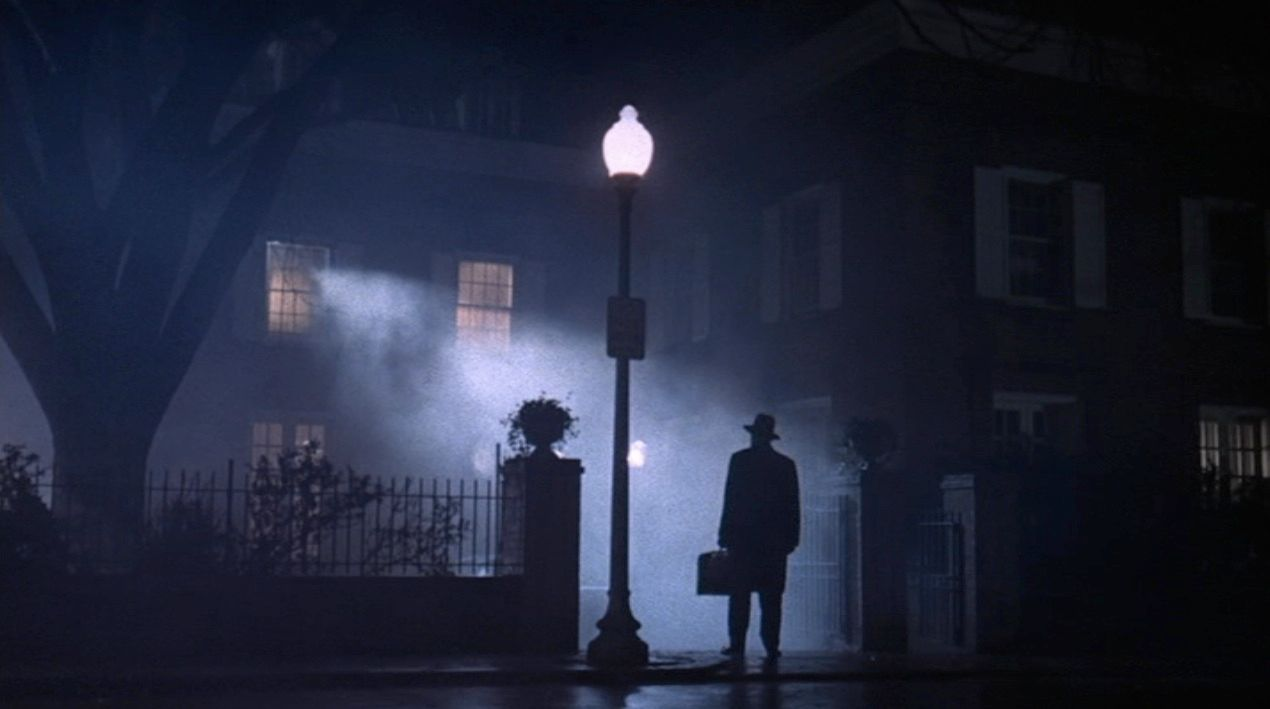 """Max Von Sydow as """"Father Merrin"""" stands outside the MacNeils' home in 'The Exorcist'"""