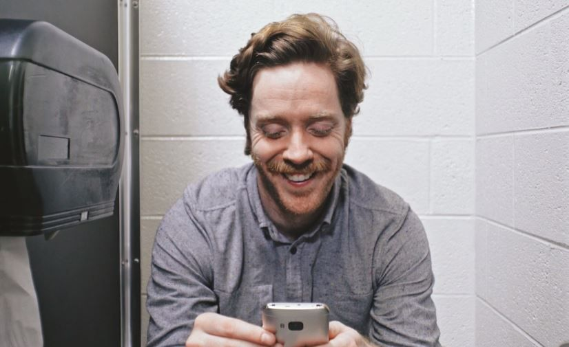 in bathroom with phone