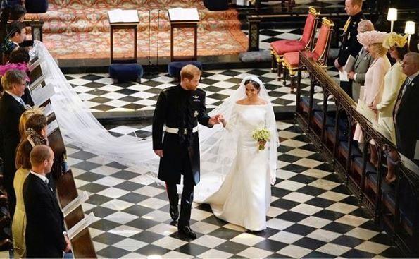 Meghan Markle and Prince Harry walk down the aisle