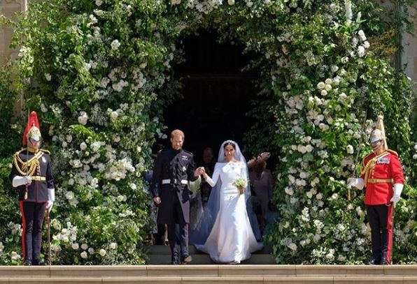 Prince Harry and Meghan Markle walk out of the chapel