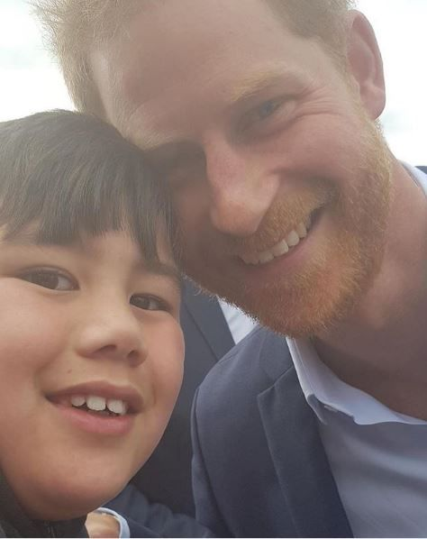 Prince Harry and Otia Nante pose for a selfie.