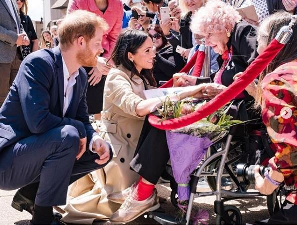 Prince Harry and Meghan Markle greet 98-year-old Daphne Dunne.