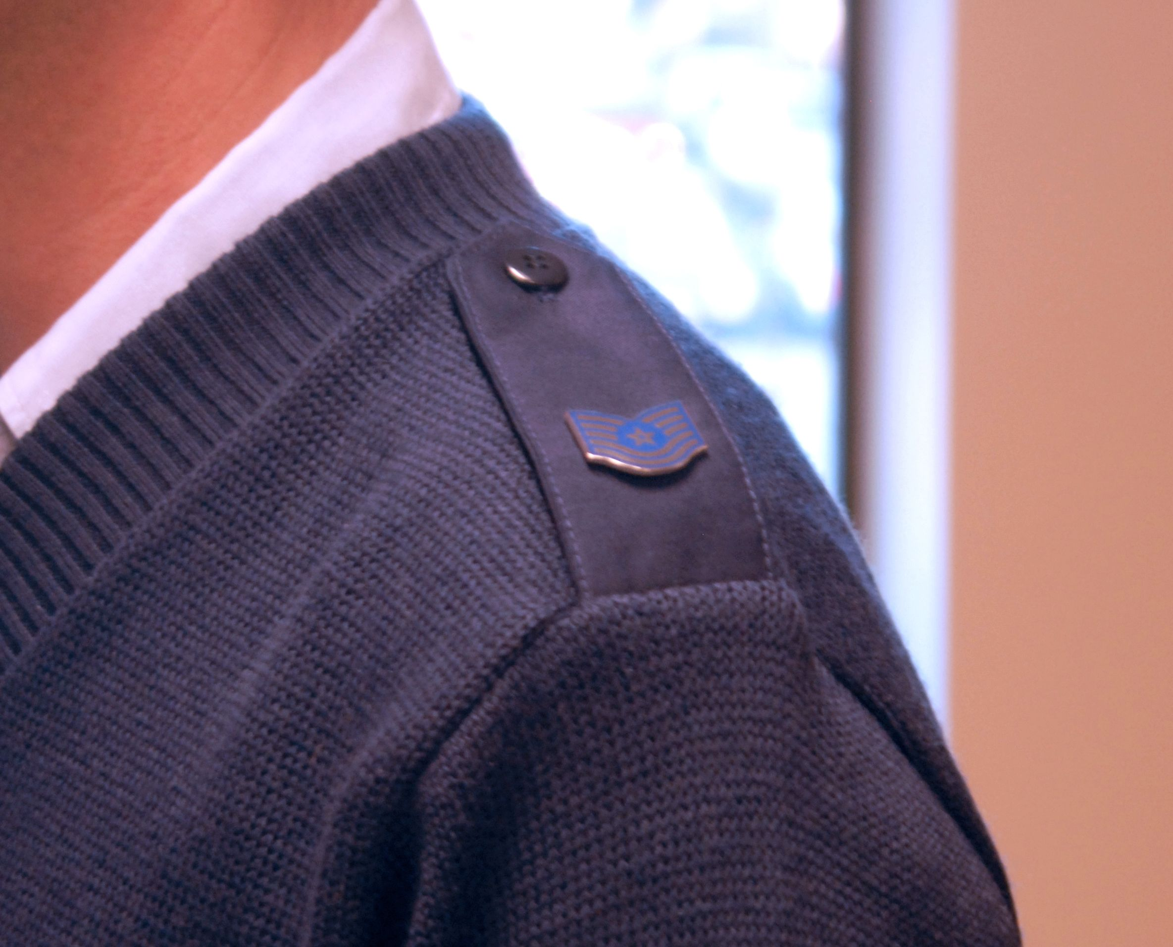 A shoulder button on a military uniform