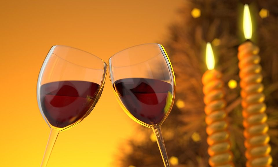 Two clinking wine glasses