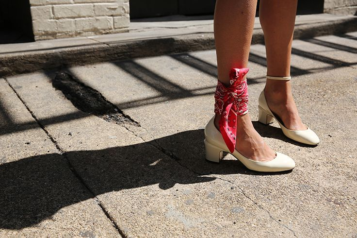 Silk scarf tied around a woman's ankle