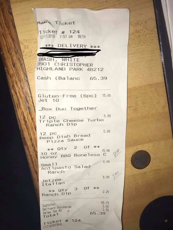 Pizza store receipt with racist message