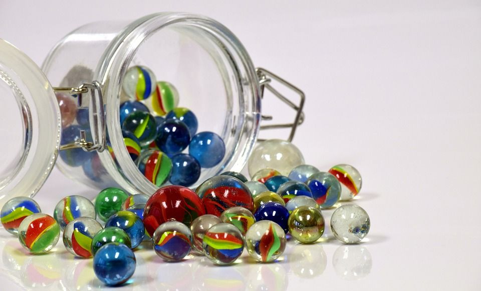 Marbles falling out of a jar