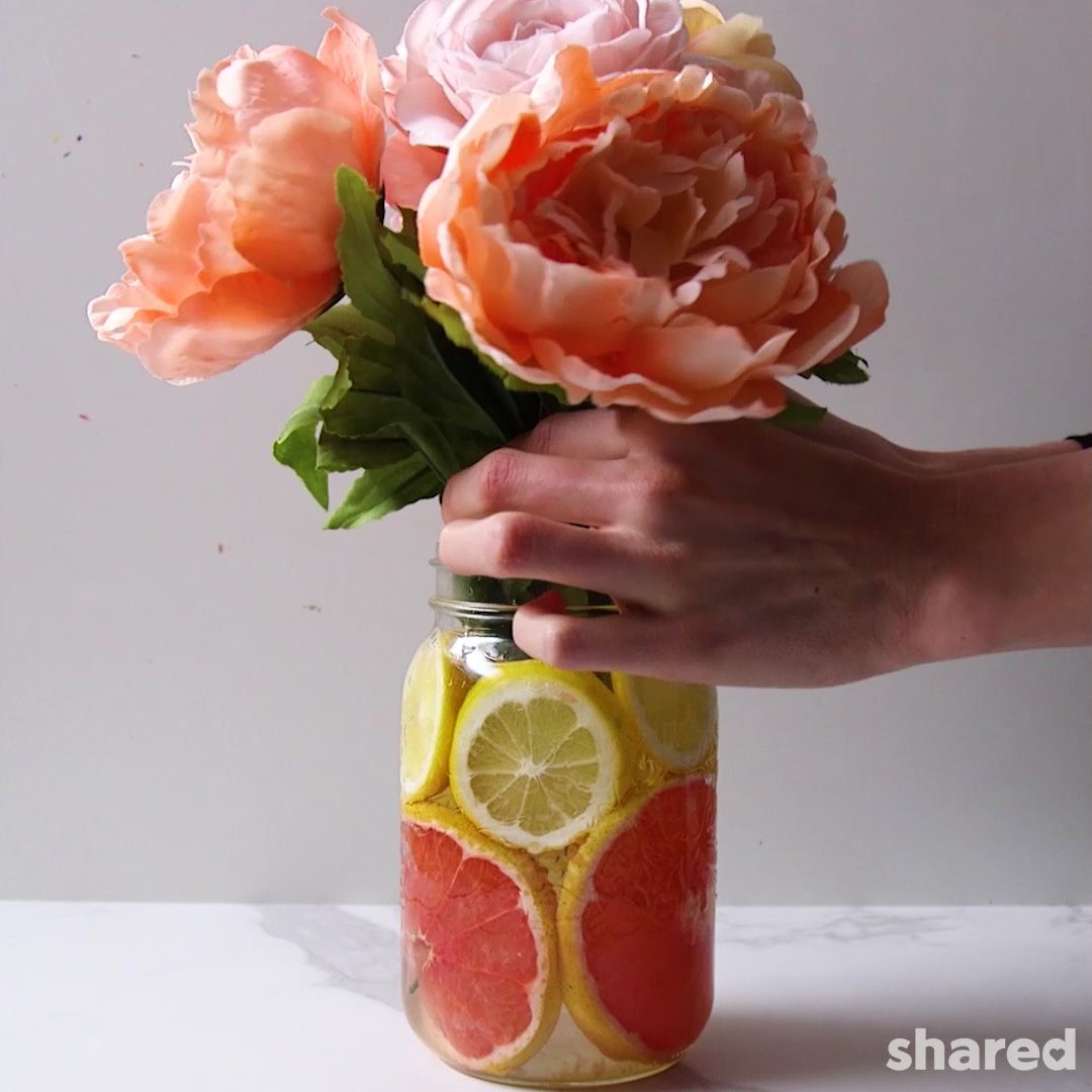peach peonie  flowers in  citrus lined flower vase by Shared
