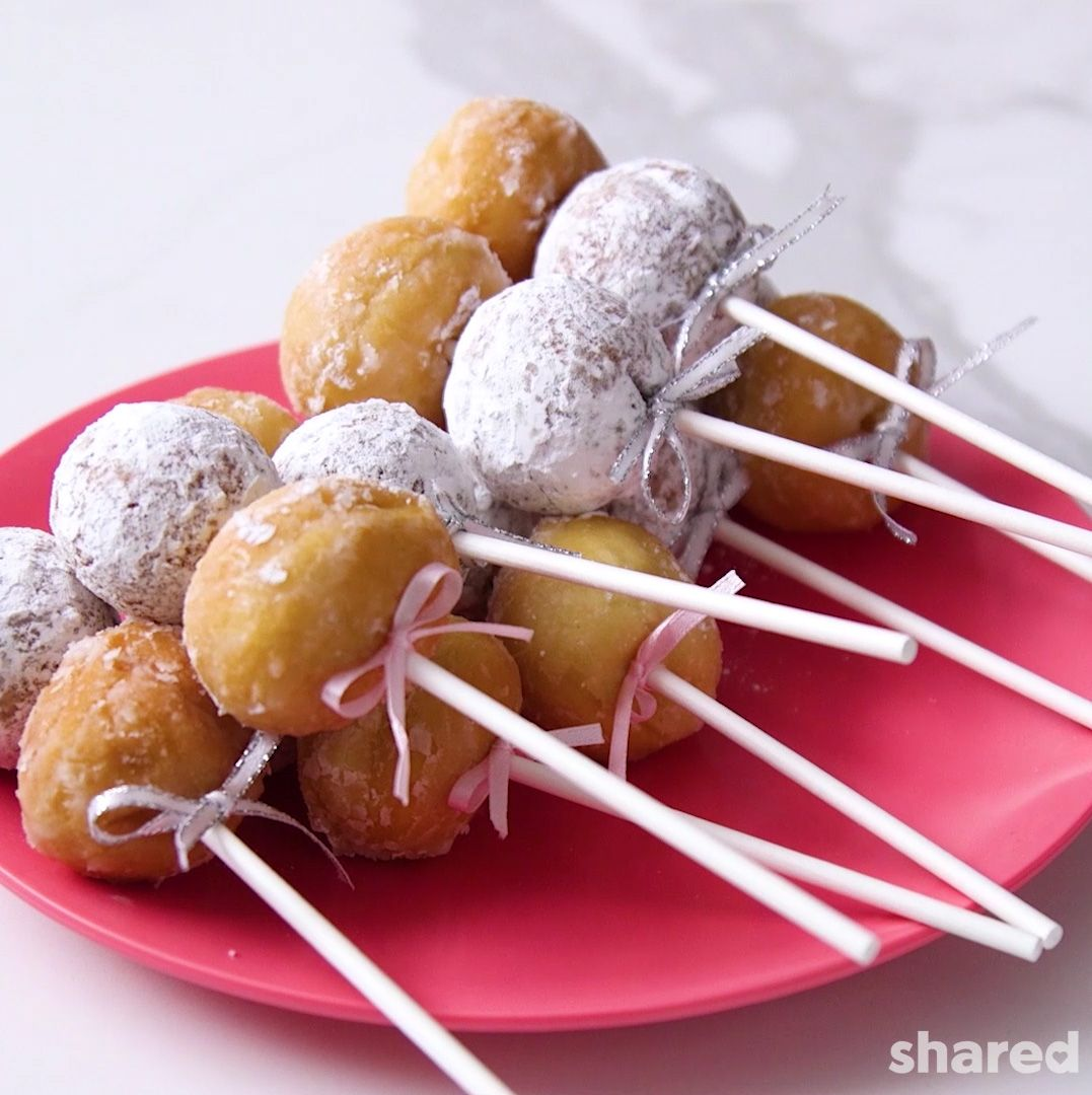 double donut holes on cake pop sticks with pink ribbon bows