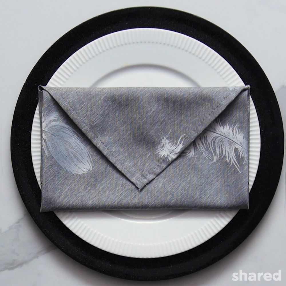 grey napkin folded into an envelope
