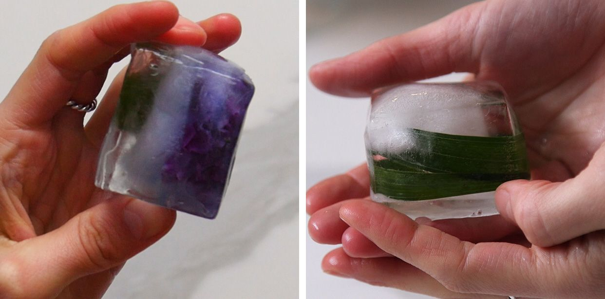 2 large square Ice cubes with flowers suspended the center
