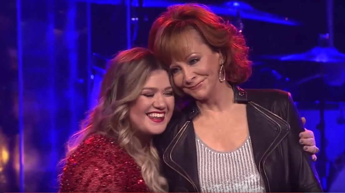 Kelly Clarkson and Reba sharing a hug