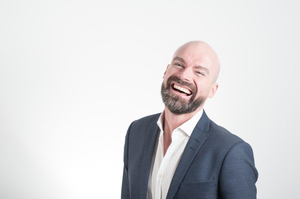 Bald man laughing