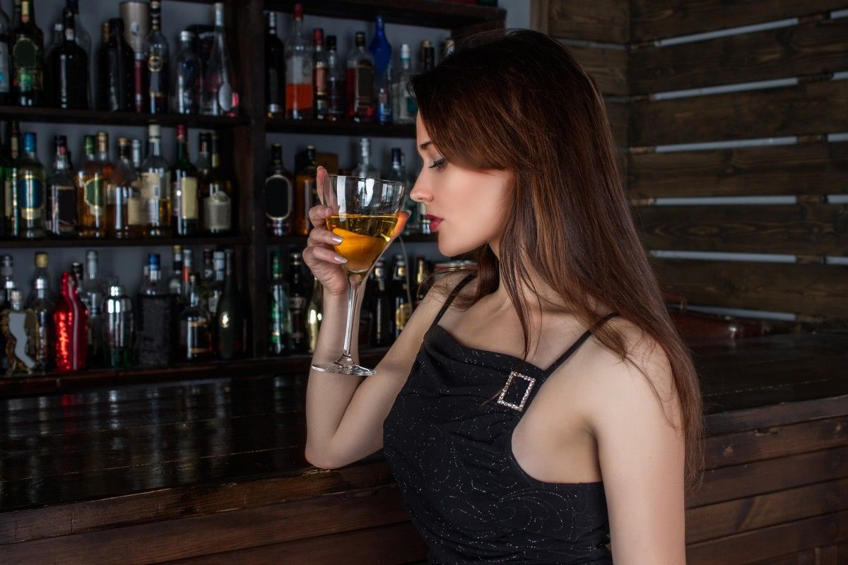 Woman drinking at a bar