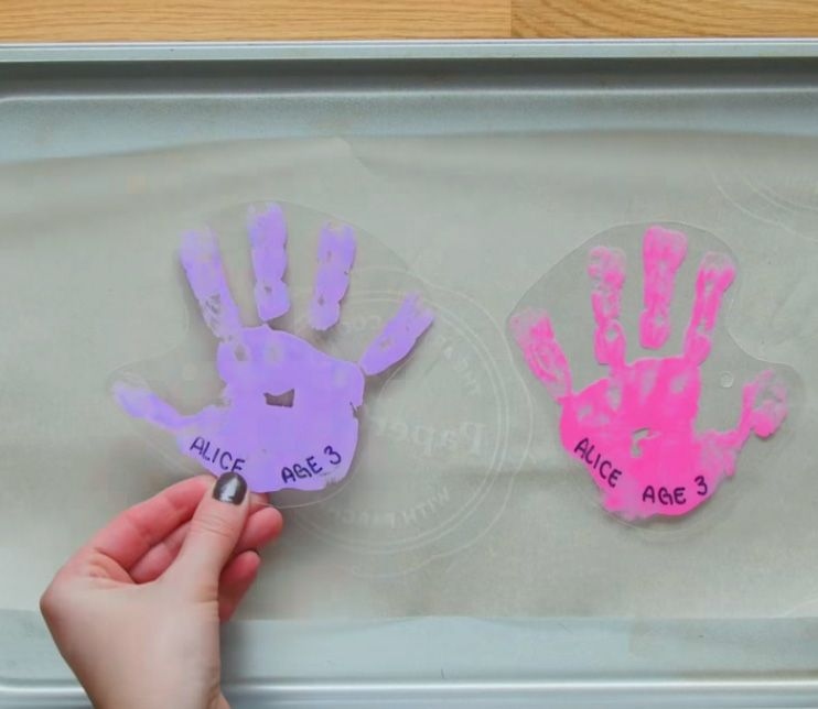 purple and pink DIY shrinky Dinks plastic key chain on baking sheet