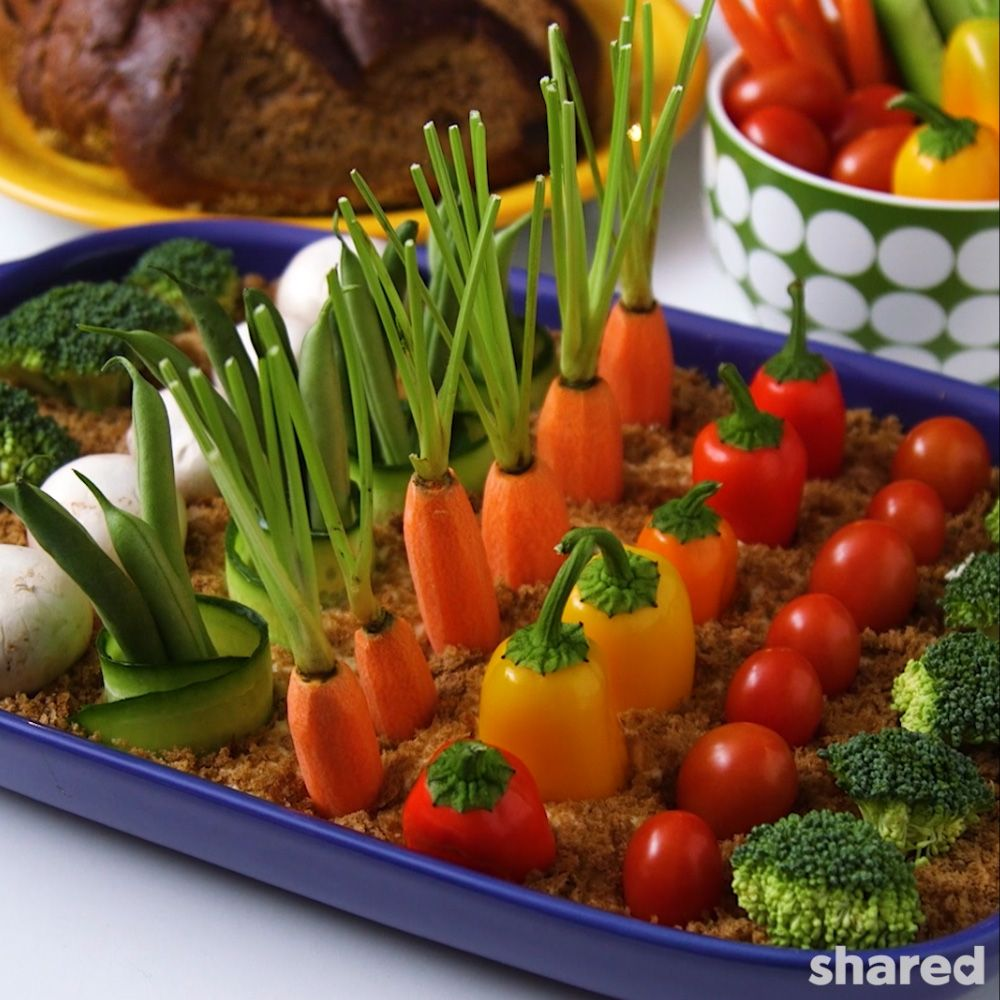 Hummus Vegetable Garden full of carrots, peppers, broccoli, mushrooms