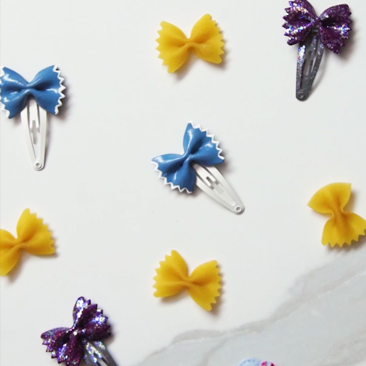 dry bowtie pasta and hair clips