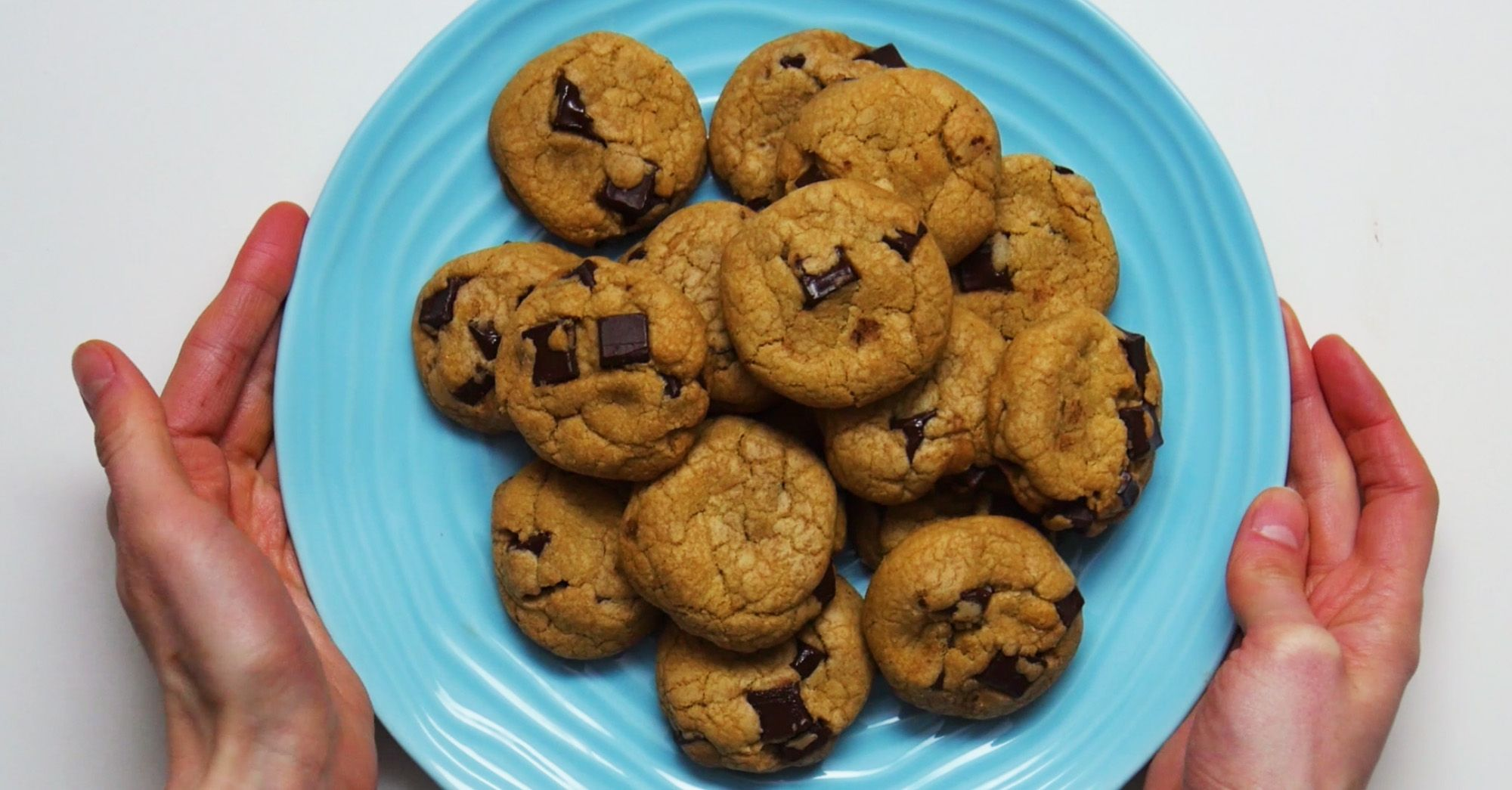 image may contain perfectly chewy chocolate chip cookies on a blue plate