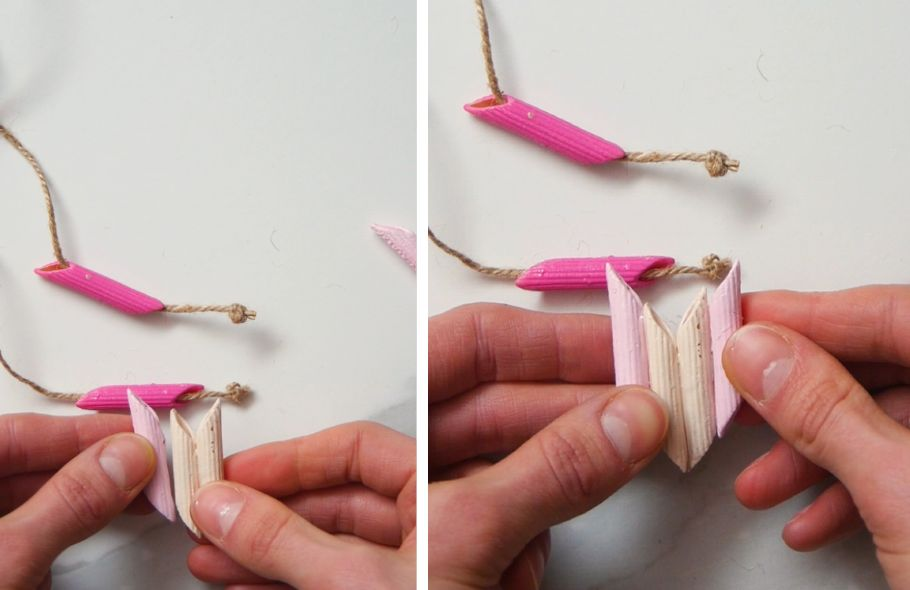 gluing penne noodles together to create a necklace pendant